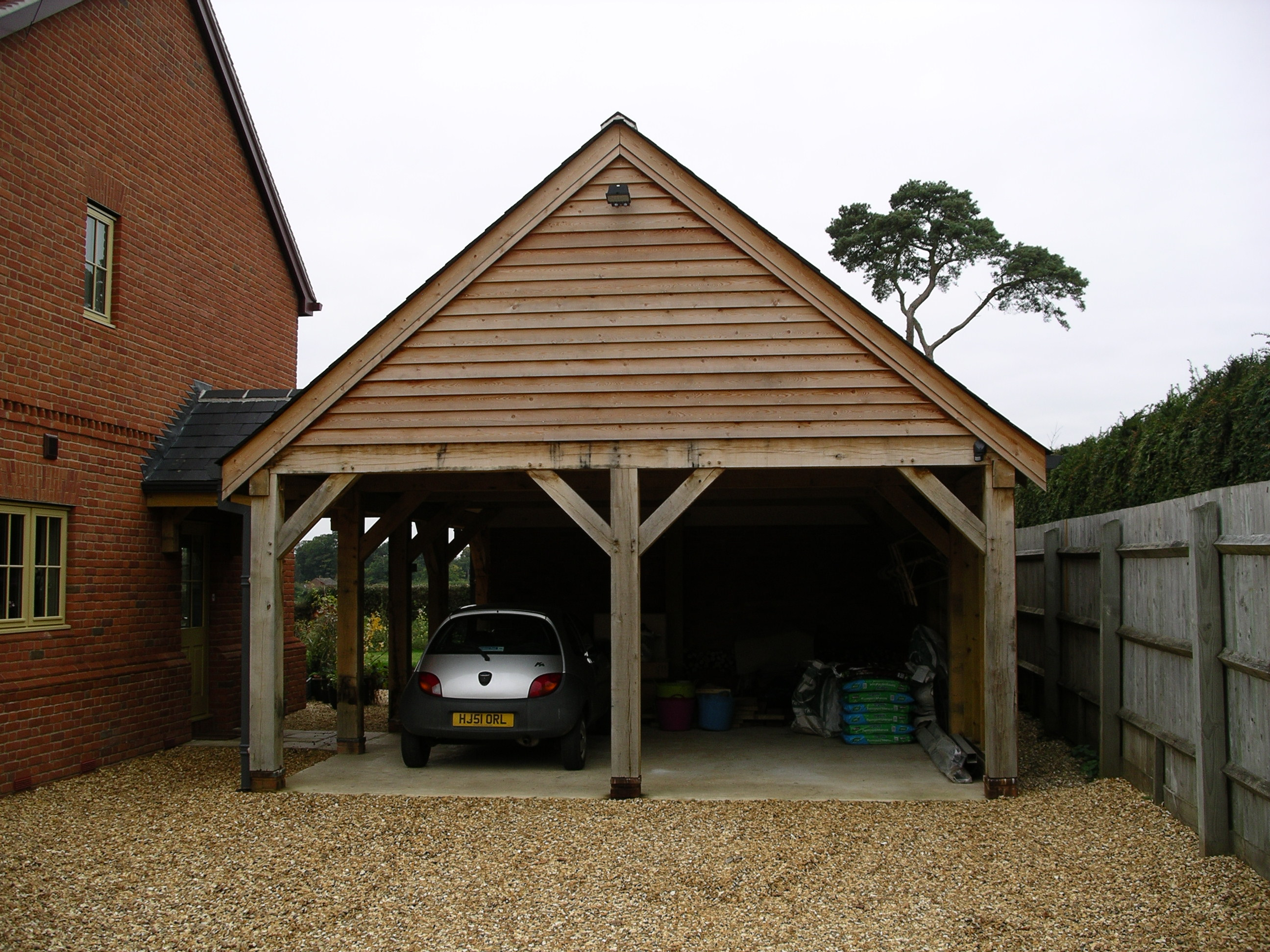 Green Oak carport seamlessly linked to the house