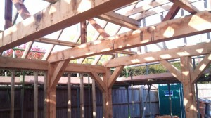 Oak frame complete and roof work is underway